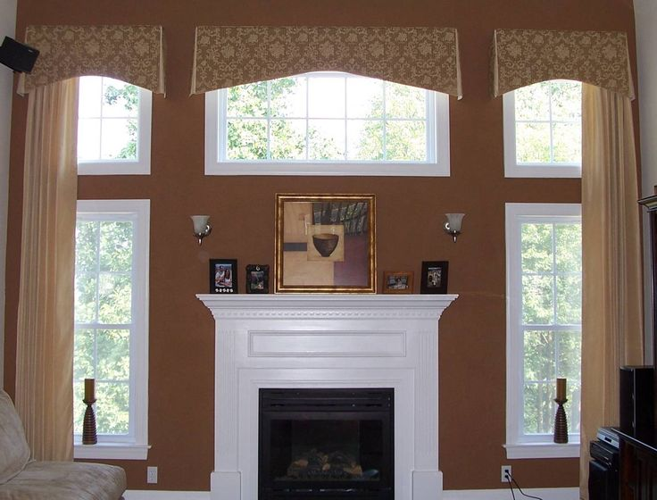 Shade Tree Interiors - handling 2 story windows with center window above fireplace. Not sure I love the valances