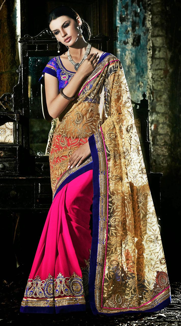 Beautiful ruby and cream faux georgette, net half and half saree which is ornamented with a moti, kasab embroidery work in the horizontal panel, aari, resham embroidery work on tha pallu part and contrast blue velvet patch on the border. Contrast blue blouse piece attached with this attire. The blouse of this saree can be stitched in the maximum bust size of 42 inches. Product Code 3FD4544575