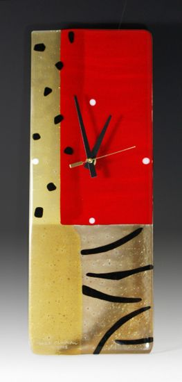 Jungle Red by Nina Cambron. Fused glass clock boldly colored in red, rich amber iridescent, and bronze, and accented by black and white dots and black stripes. Uses one AA battery, included. Signed on bottom front.