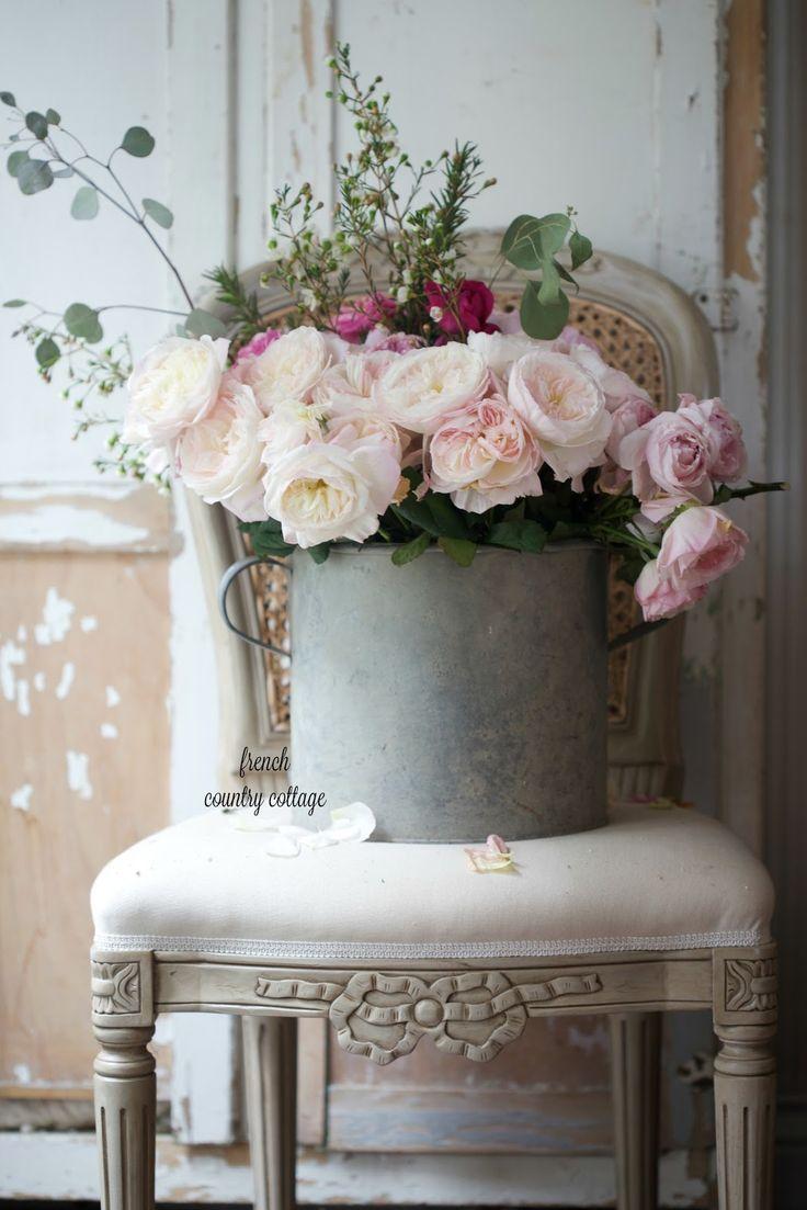 Zinc bucket filled with garden roses