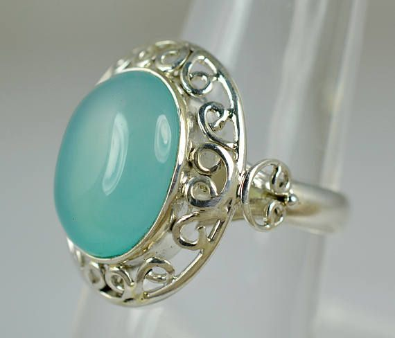Genuine Chalcedony 925 solid sterling silver handmade designer elegant ring custom sizes 3 to 14 (US)    •	Purely Handmade Ring    •	Metal: 925 Solid Sterling Silver    •	Stone: Genuine Chalcedony    •	Stone Size: Cushion 12 x 16 mm      •	All Custom Ring Sizes are available between 3 to 14 (US).    •	Kindly measure your exact Ring Size in US before order.    •	Kindly mention your Exact Ring size in Order.    •	Authentic Pure 925 Solid Sterling Silver.    •	Proudly 925 Stamped.     •	High…