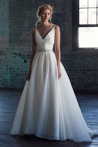 A sophisticated wedding gown with a V-neckline inspired by the Oscar dress worn by Lupita Nyong'o.