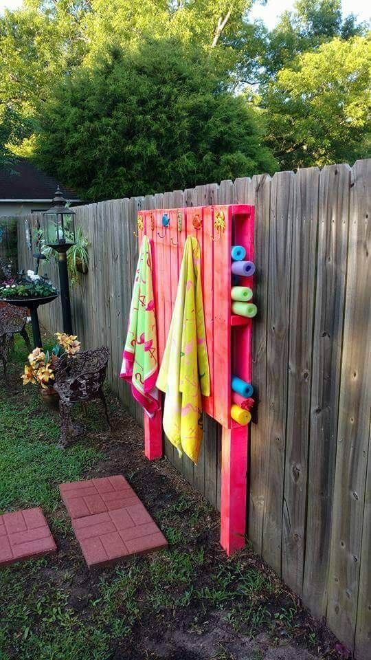 This DIY pallet project makes an awesome storage solution for outdoor pool noodles. I love that you can add hooks to hang up wet towels after swimming, too!