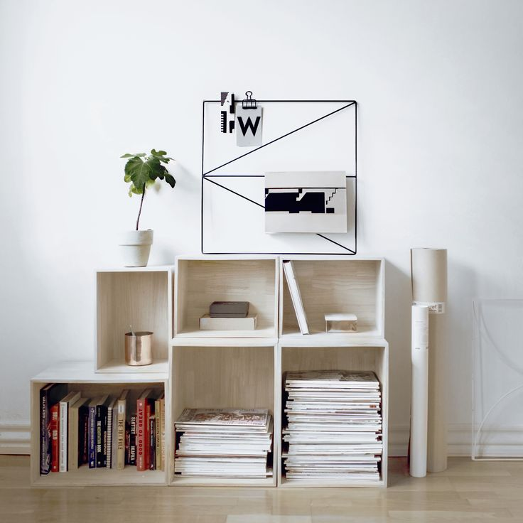 Nordic Design | Wallment Arrow Grid memo board and magazine rack in a small Scandinavian city home in Stockholm | Designed and made in Finland - New Finnish Design