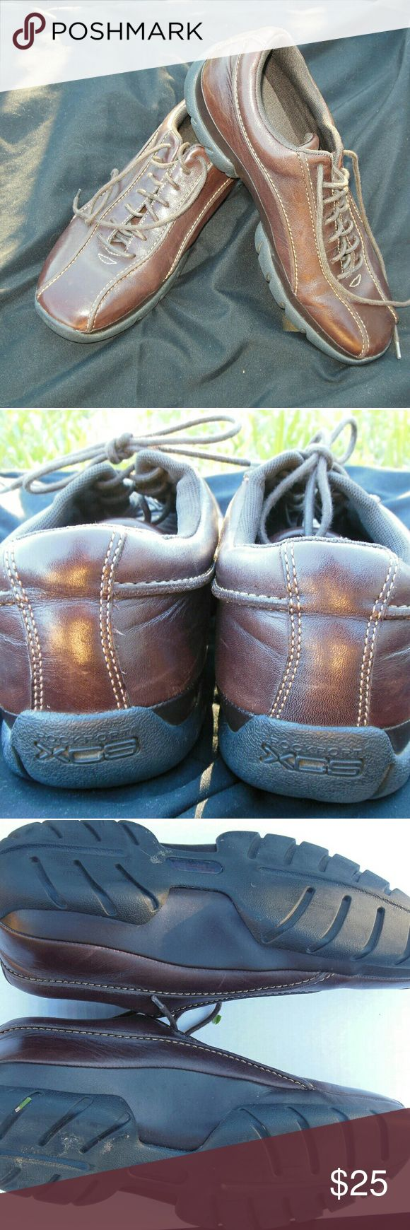 Rockport XCS Men's Casual shoe Brown leather casual shoes. Great pair of shoes for the office or even a casual weekend outfit. Shoes some signs of wear with ceasing around the ankle otherwise they are in great condition. Rockport Shoes Sneakers