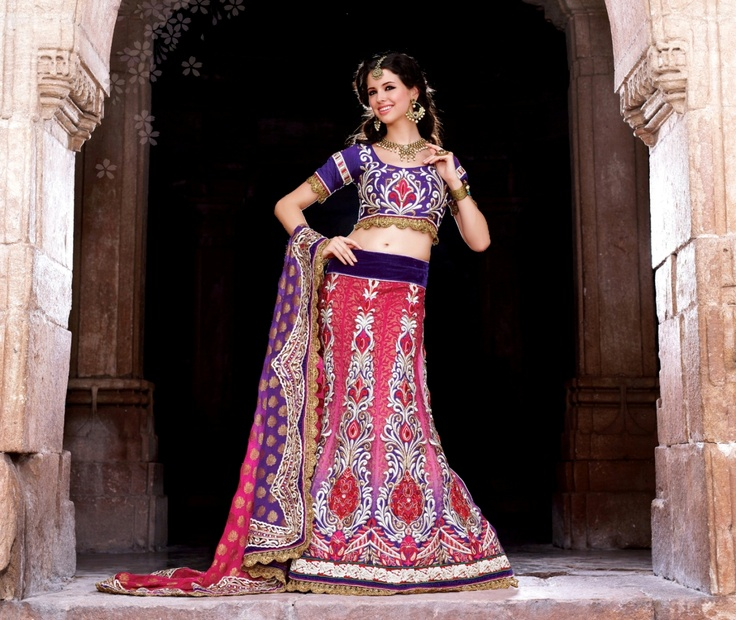 Look magnificent this season by wearing this lehenga cum saree in pink and purple colour, crafted on viscose, net, jacquard and dupian material.     For more details visit www.ashika.com