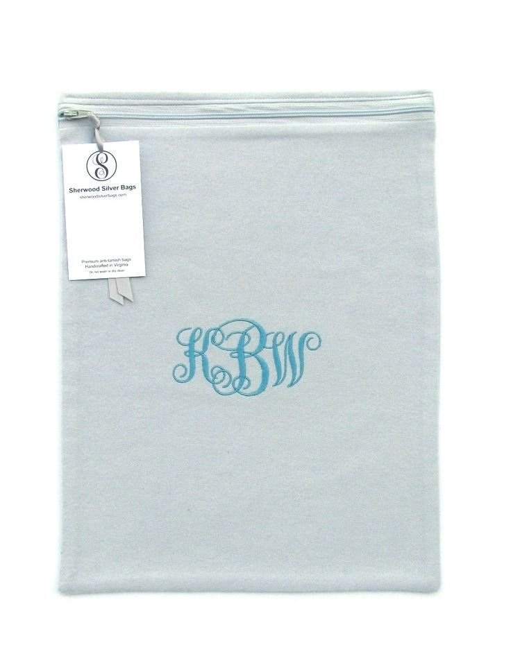 This bag is part of the Simple Elegance Collection, a transitional design that features a beautiful medium turquoise monogram that is graceful and elegant on a light gray fabric. The colors and design are perfect with both traditional and contemporary home decor styles.