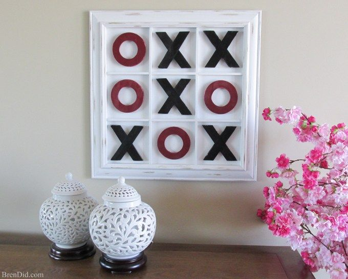 Challenge your loved ones to a rousing game of tic-tac-toe this Valentine's day on this Pottery Barn Inspired Tic Tac Toe Wall Art. It's a double duty piece that serves as an adorable piece of décor and a magnetic tic tac toe board for 67% off retail price from BrenDid.com