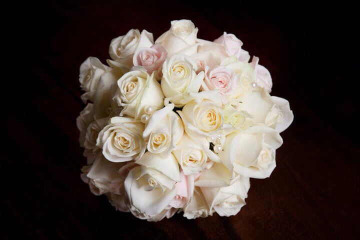 My bouquet, soft pink and white roses with pearls.
