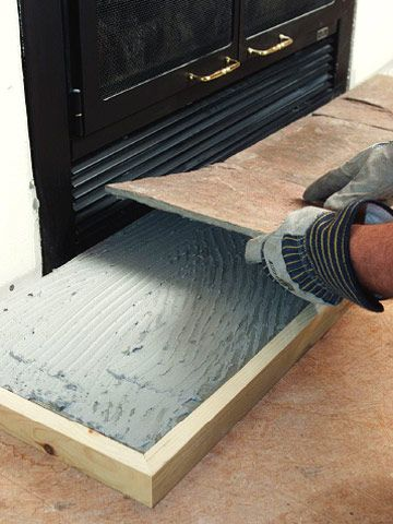 Painted fireplace hearth tile  modern jane  like the black or dark grey on hearth tiles w