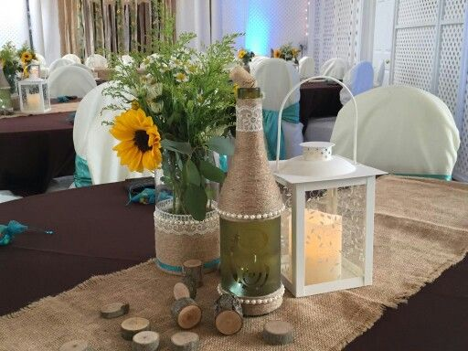 Burlap runners over brown tablecloths,  ivory chair covers and Tiffany Blue sashes..  Www.sdaffordableevents.com