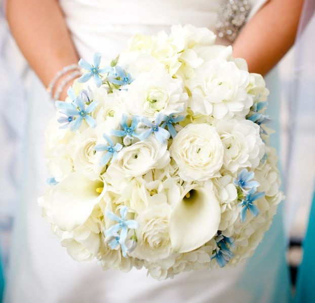 White and powder blue bouquet with tweedia.  Photo by @Amanda Wright