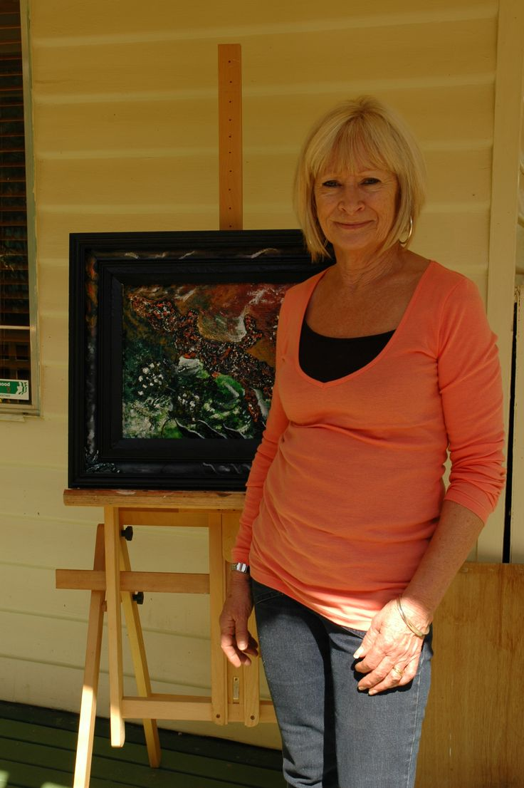 SHARON AT A ART EXHIBITION WITH ONE OF HER PAINTINGS