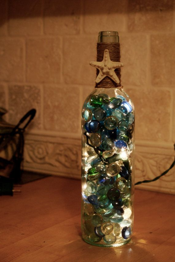 153 best images about wine bottle crafts on pinterest for Clear wine bottle centerpieces