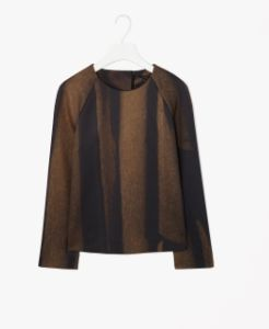 Made from a modern technical fabric with a soft interior and slight stretch, this top has an all-over tonal print. A softly structured shape with boxy proportions, it has a simple round neckline, long raglan sleeves and hidden zip fastening on the back.