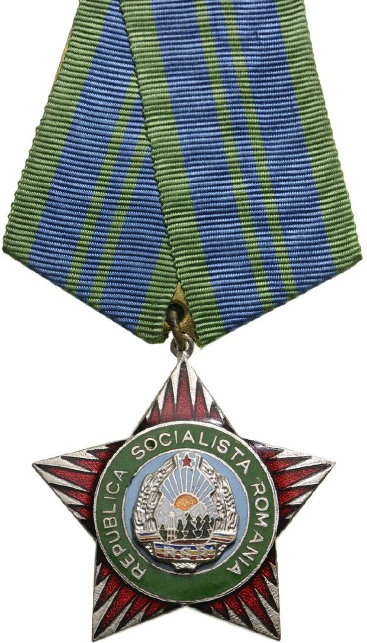 ROMANIA (RSR) - Medal PROTECTOR OF THE FATHERLAND, 2nd Model (1966-89). Breast Badge, 38 mm, Metal silvered, partially enameled
