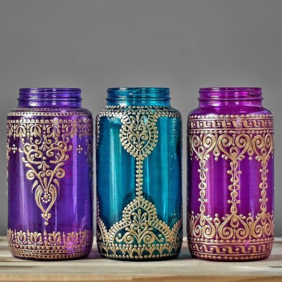 Moroccan Vase, Colorful Glass Mason Jar Vessel with Gold Accents for Table Decor, Choose One of Three Colors and Designs  This listing is for one 32 oz (quart sized) hand painted mason jar vessel. You choose from the three jars pictured, either violet glass, turquoise glass, or magenta pink glass. See a design you like but want a different glass color? No problem! Just choose the jar with the design you like, then leave me a message during checkout letting me know your glass color…