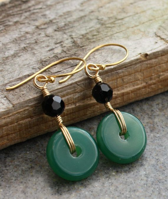 These stunning Green Jade disks is wrapped and accented with black faceted round bead and hang into vermeil gold french earwires....