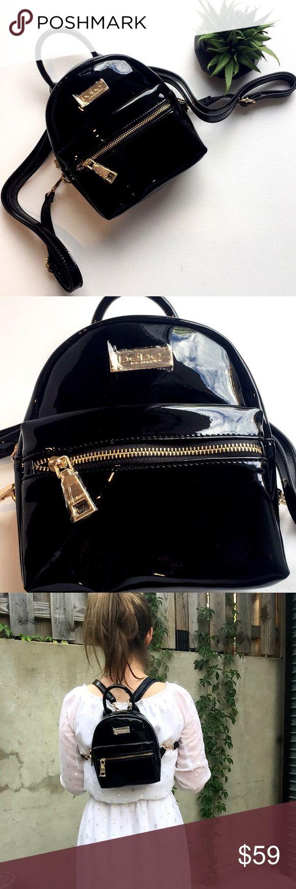 "NWOTs Bebe Mini Black Backpack NWOTS Bebe Cute backpack in a chic shiny design. Goldtone hardware adds a haute touch. Detachable adjustable straps. Goldtone bebe logo plate. 100% Polyurethane Imported Height: 9"" (23 cm), width: 7.5"" (19 cm), depth: 4"" (10.25 cm)  Top zip closure. bebe Bags Backpacks"