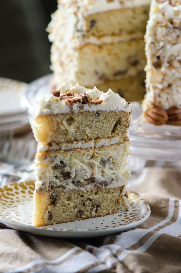 Italian Cream Cheesecake | Two layers of classic Italian Cream Cake and a complementary layer of coconut pecan cheesecake sandwiched in the middle make for one amazing dessert! Così bello!