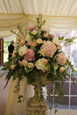 An alternative to having milk churns for your entrance flowers would be to have urns as shown here.