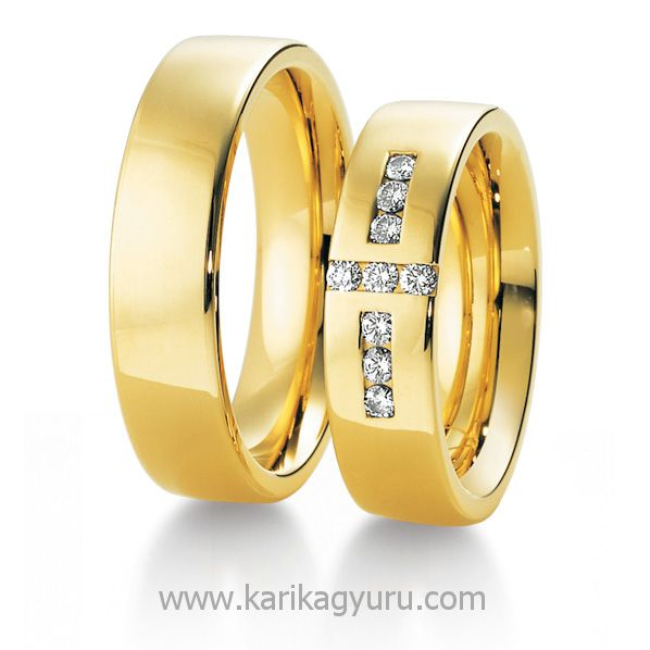 Karikagyűrű Áruház  16-18 g 14K arany. Női gyűrűben összesen 0,27 ct G, vs minősítésű briliánssal.