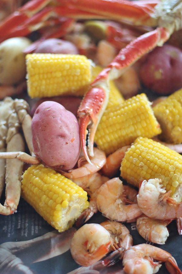Shrimp and Crab boil with potatoes and corn. A fun, casual meal that's scattered on newspaper down the middle of the table.