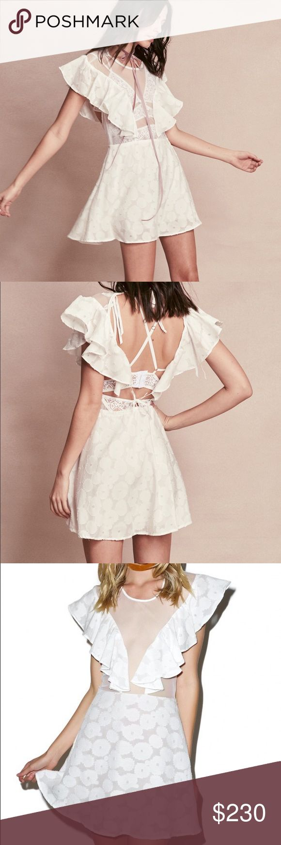 For Love and Lemons Buttercup Dress For Love & Lemons Buttercup Mini Dress.  this gorgeous little dress is beautifully constructed from a super soft burnout daisy print and flattering A-line flowing skirt with nude lining. Featuring a slim fitting sheer bodice perfect for wearing solo or layering a pretty bralette underneath with cascading ruffle accents and sensual open back with dual tie closures.  Materials: 55% Silk, 45% Cotton; Lining: 100% Nylon Dry Clean Only Last model wears XS and…