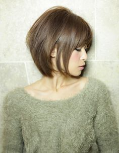 short, but not too short, like bangs & slight layers for someone with straight hair