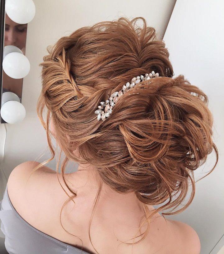Unique messy updo wedding hair with braids | fabmood.com #weddinghair #hairstyleideas #hairstyles #weddingupdo #upstyle #chignon #bridalhair #braidhairsyle #messyupdo #messyhairstyle #braids #braidupdo #hairstyleideas