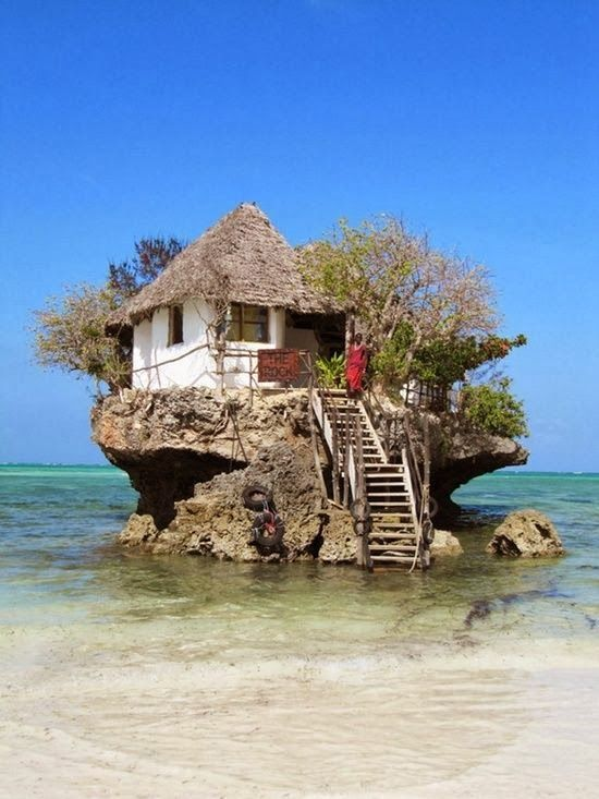 little cottage on a rock, in the ocean