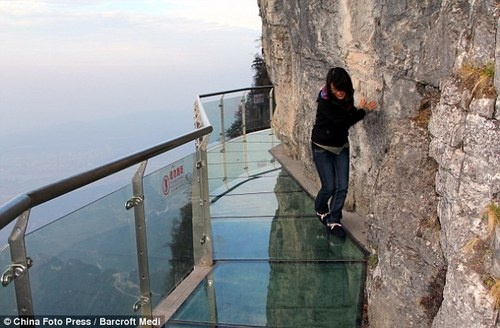 China's newest tourist attraction… a glass-bottomed walkway around a cliff face     On one side a sheer rock face, on the other a 4,000ft drop - and all to separate the brave traveller from a deadly plunge is a 3ft-wide, 2.5in thick walkway.  Tianmen Mountain in Zhangjiajie, China.Walks, Glasses, The Face, Strange Facts, Beautiful Landscapes, Travel, Places, China, Tianmen Mountain