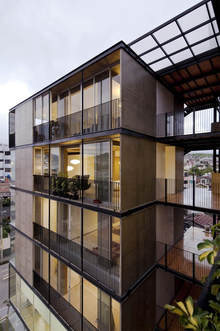 031-60;98 Building by Espinoza Carvajal Arquitectos A bulky volume with lightweight appearance, achieved with refined details and various materials to break up the volume.