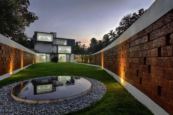 The Running Wall Residence by LIJO RENY architects