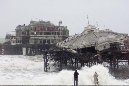 The Argus: The West Pier tilts over at a severe angle in this picture taken in January 2003. It has been disappearing into the sea since the...