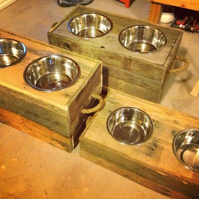 Dog Bowls made out of old pallets....or even easier-find a crate, turn it upside down and put some holes for the food bowls. Seems much easier!