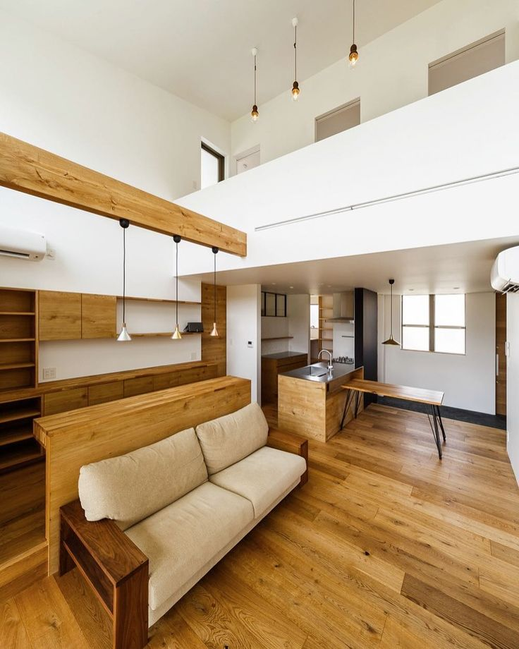 By far one of the most beautiful #interiors you'll ever see, the commitment to wood-and-white in this space results in a striking, #stylish result. Blessed by a towering, open #ceiling, the team from Koba Haus have taken full advantage of all corners for a result that we can't take our eyes off. Head to homify.com to find your #dreamhome!  #house #home #interiordesign #inteirordecor #homedesign #homedecor #modernhouse #modernhome #moderninterior #livingroomideas #livingroom #scandinavian…