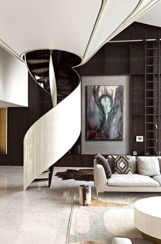 Sculptural staircase. Candy white Gloss and chocolate tones.