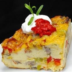 This layered breakfast casserole has cheese, eggs, and a whole lot of hearty goodness.  I toast the bread first and I use half swiss cheese and half cheddar.