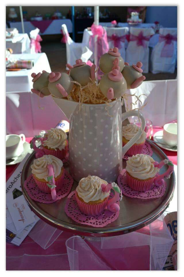 Tea party cake pops and cupcakes. Made by The Dotted Apron Bloemfontein. https://m.facebook.com/profile.php?id=703914623013978&refsrc=https%3A%2F%2Fwww.facebook.com%2Fpages%2FThe-Dotted-Apron%2F703914623013978