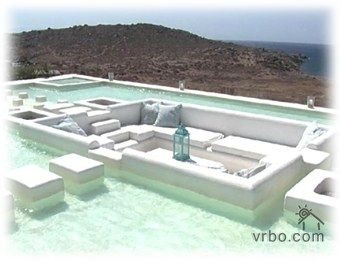 Villa In Mykonos With A Sunken Living Room Into The Rooftop Pool