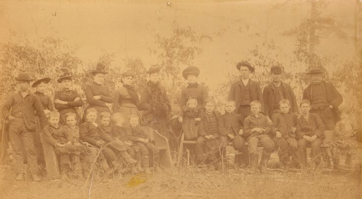 Paulita Maxwell (standing sixth from left) was a resident of Fort Sumner, New Mexico and the daughter of pioneer landowner Lucien Maxwell. American Old West outlaw Billy the Kid was killed by Sheriff Pat Garrett in the Maxwell home in 1881. - Courtesy Jay McCarey Collection