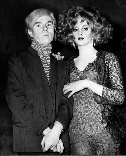 Andy Warhol and the star of his movies Candy Darling. His name was James Slattery until in 1963 he started the course of hormone injections and became a woman.
