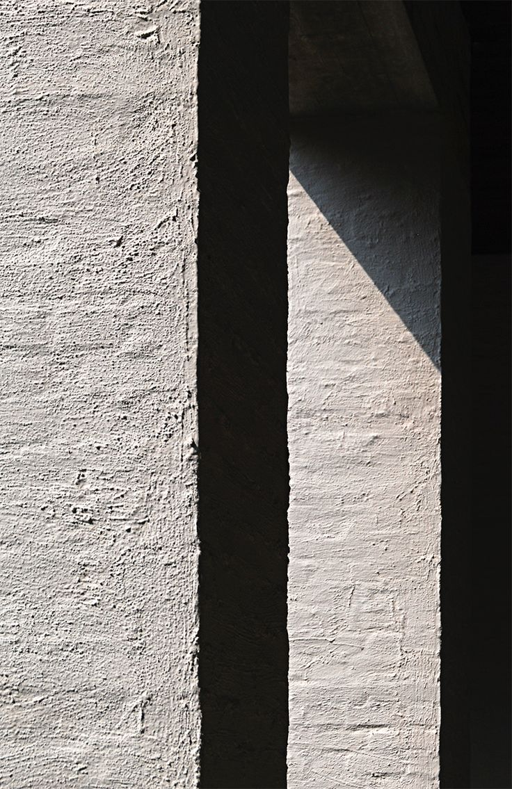 The materiality of architecture brought to life by the sun. Rendered stone of the Vaals abbey by Dom Hans van der Laan. Photo by NOMAA marco jongmans.