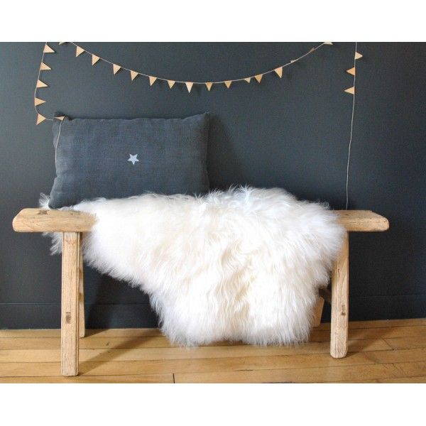 I like that simple bench with a sheepskin draped over it.