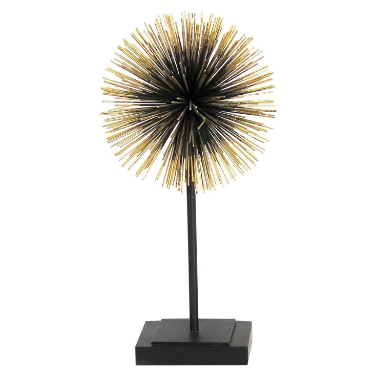 Add style to any room with this contemporary metal tabletop accessory by E2 Concepts for Masterpiece Art Gallery.  This decorative tabletop figurine features a deep bronze & gold finish with a single modern starburst silhouette.  Display this item alone or pair with other decorative accessories by E2 Concepts for Masterpiece Art Gallery.  Wipe clean with a dry cloth.   Each piece sold separately.