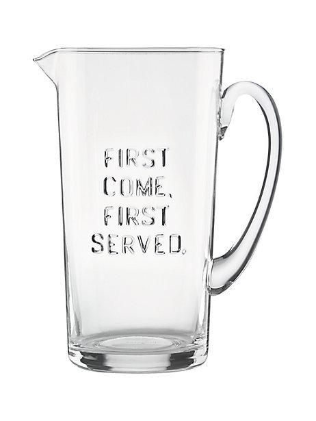 """this glass pitcher, which bears the motto """"first come first served,"""" is a stylish vessel for ice water, sangria or fresh-squeezed lemonade."""