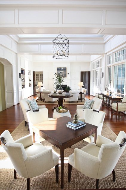 Eclectic living room & game room merged together as one with like furniture and accessories to create a large room feel