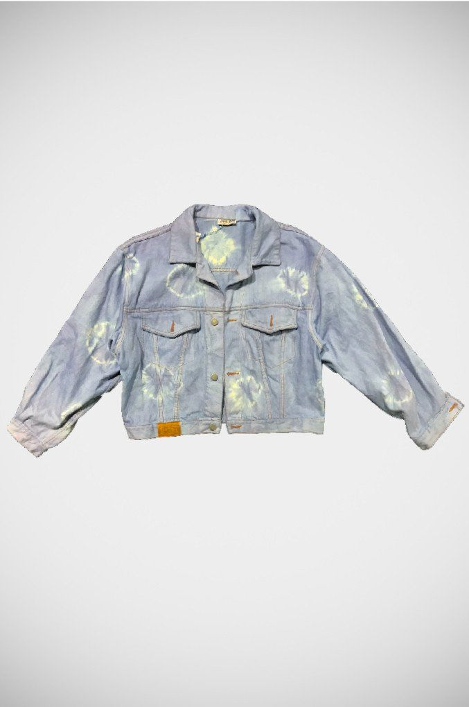 A tie dyed one of a kind denim jacket. A vintage piece that has been hand tie dyed in a blue hue. A cross between a moto and boyfriend jacket, it is a beautifully fitting piece.