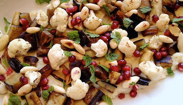 Salad with roasted cauliflower, cauliflower puree, aubergine, mint, almond and pomegranate